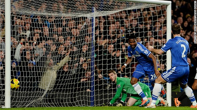 Samuel Eto'o (center) celebrates with Branislav Ivanovic after completing his hat trick for Chelsea against Manchester United