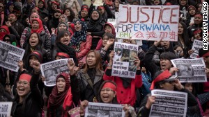 Protesters march in support of an Indonesian worker allegedly tortured by her employer in Hong Kong on January 19, 2014.
