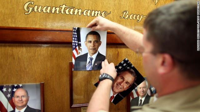 President Barack Obama signed an executive order on January 22, 2009, to close the detention facilities at Guantanamo Bay, Cuba, within a year. Nearly six years later, the prison for terrorism suspects remains open. Click through for a look inside the controversial facility. Here, President George W. Bush's official picture is replaced by Obama's in the lobby of the headquarters of the U.S. naval base at Guantanamo on January 20, 2009, the day the latter was sworn in as president.