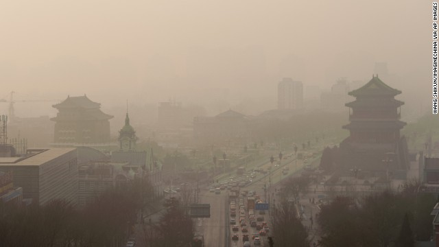 Vehicles move slowly through heavy smog in Beijing on Thursday, January 16. China's manufacturing of exports generates pollution that harms air quality -- not only in Asia but also all the way across the Pacific Ocean in the <a href='http://www.cnn.com/2014/01/20/health/pollution-china-pnas/index.html'>Western United States</a>, according to a new study.
