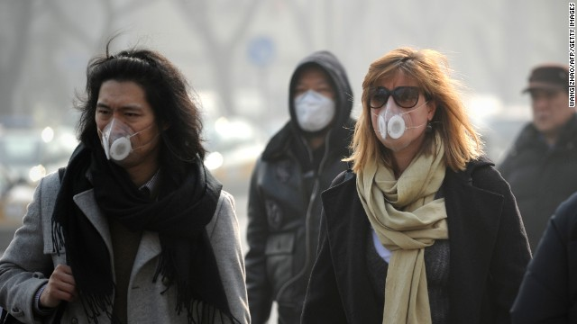 People use face masks during their commute in Beijing on January 16. The Chinese government is trying to control the number of new vehicle registrations this year in some cities to help improve air quality, <a href='http://money.cnn.com/2014/01/20/autos/china-autos-pollution/'>CNNMoney reports</a>.