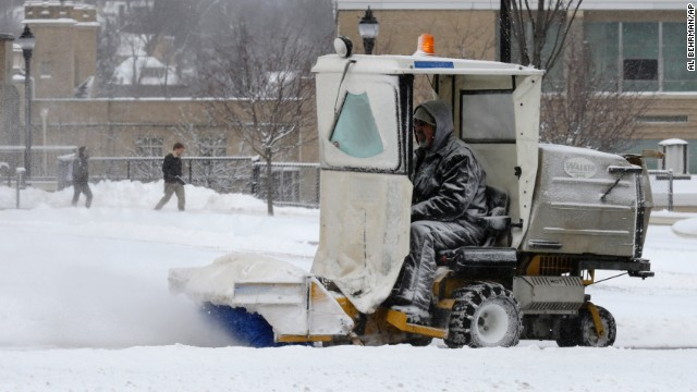 A worker clears snow off sidewalks at Xavier University in Cincinnati, Ohio, on January 21.