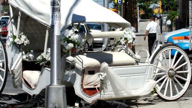 A carriage drawn by two horses on its way to pick up a wedding party was smashed when it was struck by a livery cab in Brooklyn in 2008. The driver and horses were injured.