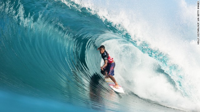 Kahea Hart surfs during the Billabong Pipe Masters in Memory of Andy Irons at Backdoor, on Oahu, in 2013. An experts-only spot, the reef bottom here creates potent, hollow, fast and intimidating world-class tubes.
