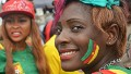 A Cameroon supporter smiles during celebrations after Cameroon qualified for the 2014 FIFA World Cup in Brazil after winning the second leg qualifying football match between Cameroon and Tunisia on November 17, 2013 in Yaounde.