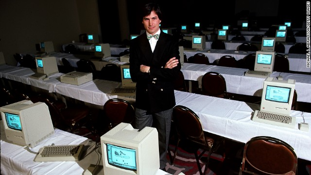 Apple co-founder Steve Jobs poses in 1984 with a room full of original Macintoshes. The machine packed 128K of memory -- tiny by today's standards -- and sold for $2,495.