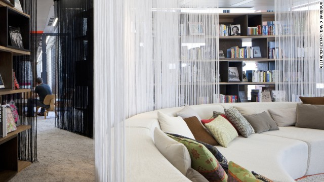 Designers didn't want any particular aesthetic to dominate the building, so interiors move from quirky and colorful to sleek and stylish. The modern library, for instance, offers a tranquil atmosphere dominated by a circular sofa.