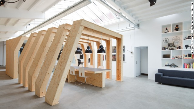 <a href='http://www.onesize.nl/' target='_blank'>OneSize</a>, a motion graphics firm in Amsterdam, have created a series of contrasts within their 300 sq. m office. The exterior is essentially a sleek white box. Inside, however, a series of raw wooden ribs are used to create an open conference room. Enclosed wooden spaces are also available for more private employees.