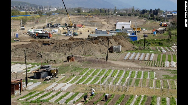 According to some residents, however, the construction work for the 2014 Games has spoiled the surrounding countryside. Here, people work on their vegetable gardens near the construction site of the Olympic facilities in the Imeretinskaya Valley.