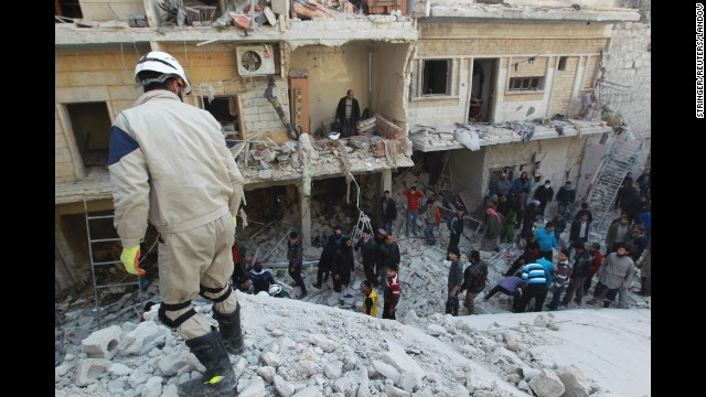 Residents search for survivors in Aleppo on Saturday, December 28, 2013, after what activists said were airstrikes by forces loyal to Syrian President Bashar al-Assad.