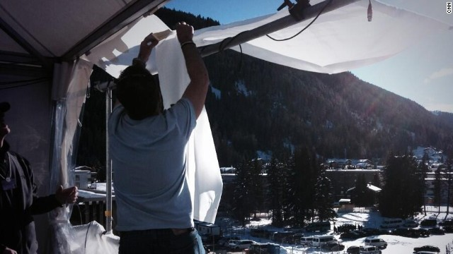 Team CNN is down to t-shirts in Davos on Wednesday, putting up makeshift sunshades in the mountains.