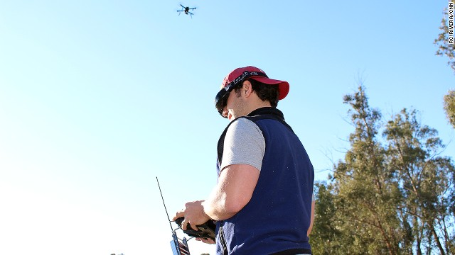 <a href='http://3drobotics.com/' target='_blank'>3D Robotics</a> employee Pablo Lema views live video streamed from the drone above his head. The first-person view is displayed on his goggles, while he steers the device with a hand-held controller.