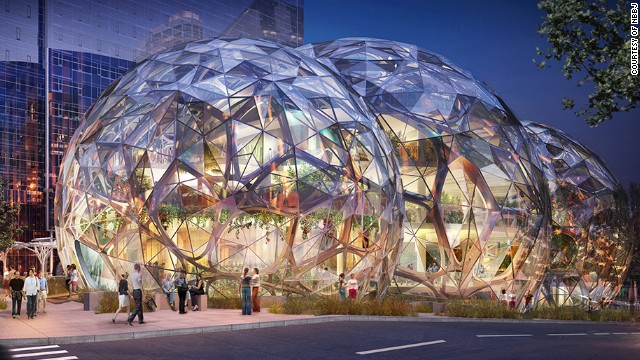 "<a href='http://www.nbbj.com/work/amazon/' target='_blank'>NBBJ</a>, the architecture firm behind Amazon's new Seattle offices, say their goal is to ""build a neighborhood rather than a campus."" Around 1800 employees will eventually work inside three glass orbs, each of which will boast hanging gardens and plenty of sunlight. The community-focused design also calls for a public dog park and retail space."