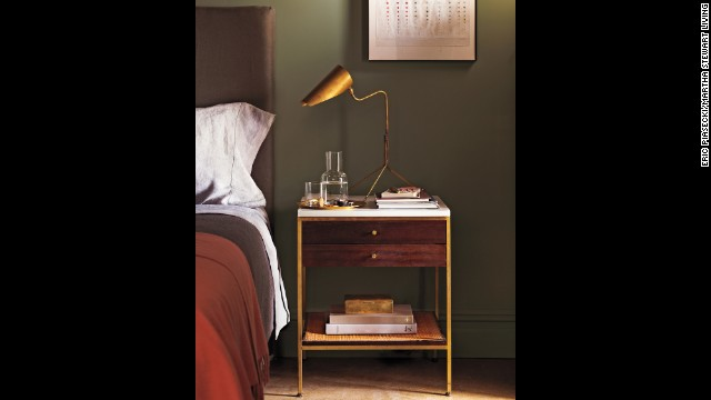 Brass works well with so many furniture periods. Here, a vintage gilt edged Paul McCobb end table is paired with a contemporary brass lamp.
