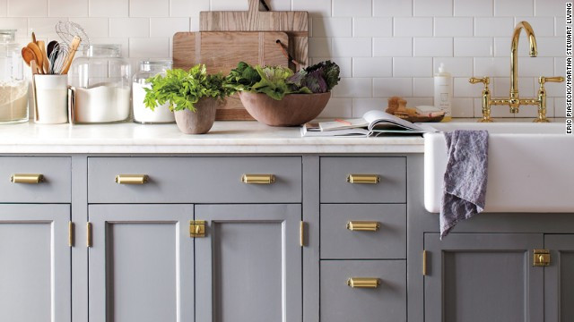 No need for a gut renovation. Revitalize your kitchen with a fresh paint color and stylish new hardware. We updated all white cabinets with a coat of gray and a sprinkling of brass. Martha Stewart's tip: When it comes to architectural details, don't mix metals.