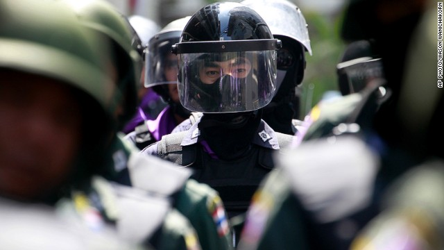 Thai policemen form up a line as anti-government protesters stage a rally in Bangkok on January 22, 2014.