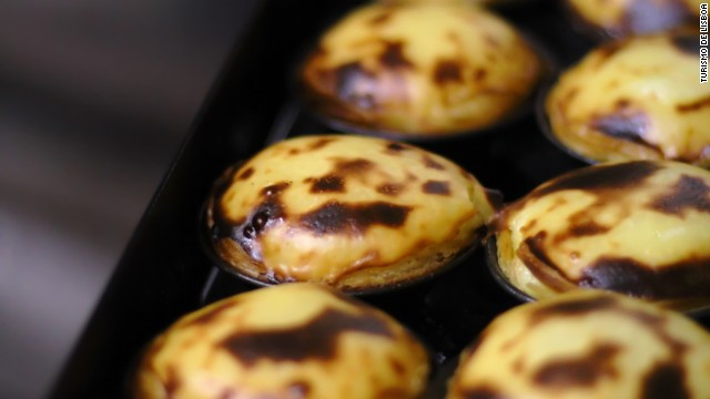 Portuguese custard tarts have conquered the world. You can try the original version (pictured) at the Antiga Confeitaria de Belem café.