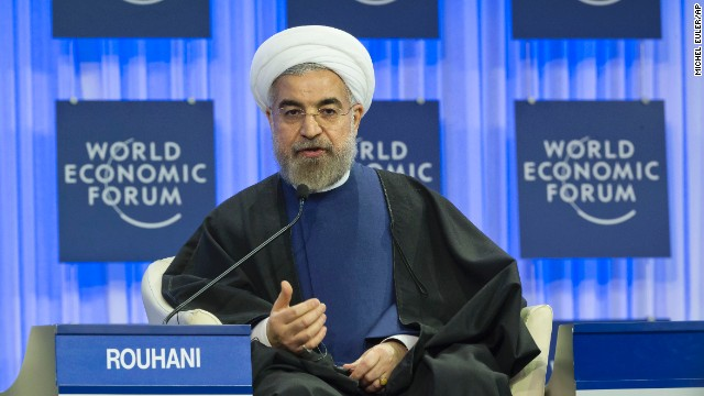 Iranian President Hassan Rouhani takes the stage on Thursday morning, declaring Iran will continue its nuclear program for peaceful purposes
