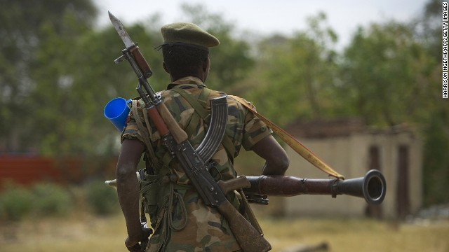A South Sudanese People's Liberation Army soldier patrols in Malakal, South Sudan, on Tuesday, January 21. South Sudan erupted in violence on December 15 when rebels loyal to ousted Vice President Riek Machar tried to stage a coup. Violence quickly spread, with reports of mass killings emerging nationwide.