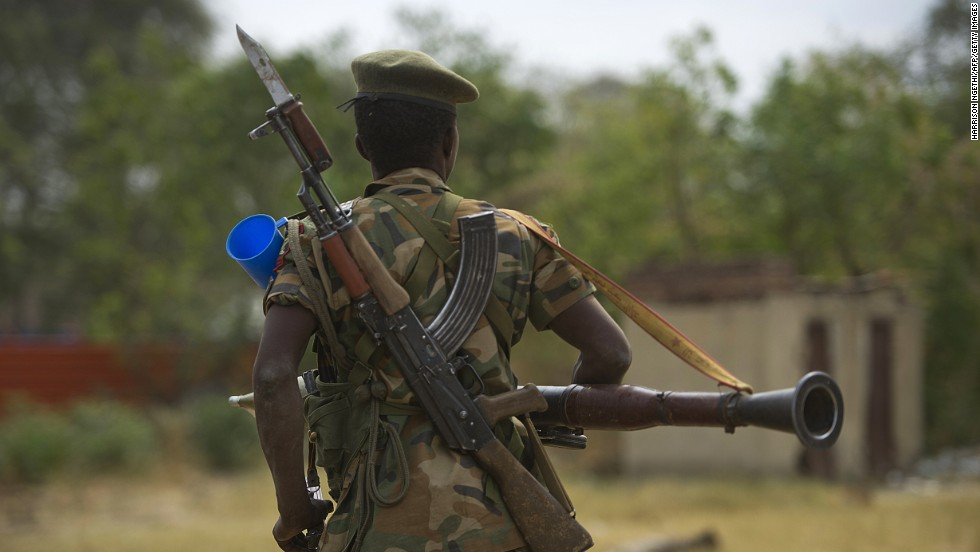 A South Sudanese People's Liberation Army soldier patrols in Malakal, South Sudan, on Tuesday, January 21.<!-- --> </br>South Sudan erupted in violence on December 15 when rebels loyal to ousted Vice President Riek Machar tried to stage a coup. Violence quickly spread, with reports of mass killings emerging nationwide.