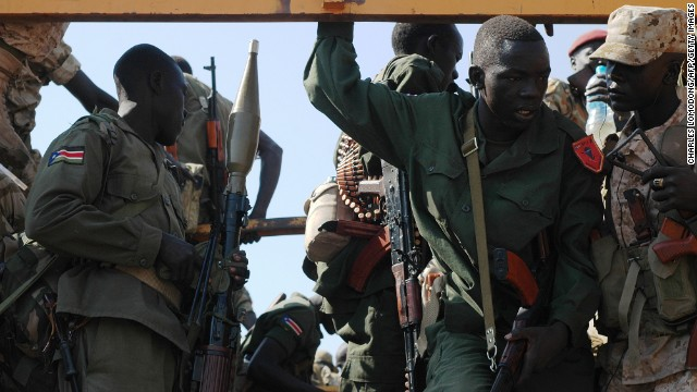 Government soldiers prepare to deploy from the capital, Juba, on January 13 as fighting continues to rage in South Sudan.