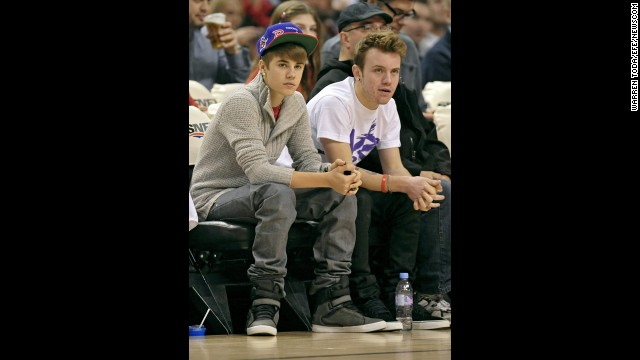 Even as he's become astronomically famous, Bieber hasn't lost touch with his Canadian childhood friends. Ryan Butler (pictured right in 2011) is a familiar face to Beliebers both on and off the red carpet, and he considers Bieber a brother. On Twitter, you'll often catch him offering Bieber supportive tweets like this one.
