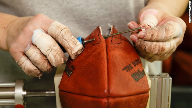 Donna Connelly threads the laces of an official Super Bowl game ball at Wilson Sporting Goods in Ada, Ohio, on Monday, January 20.