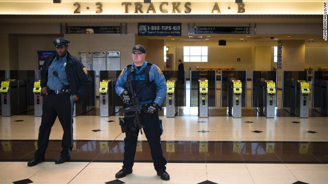 New Jersey Transit Police in Secaucus, New Jersey, stand watch over a news briefing Thursday, December 9, concerning transportation to the Super Bowl.