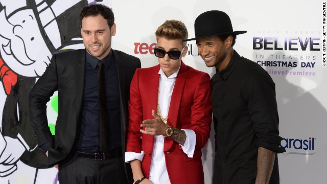 Justin Bieber is rarely spotted without a crew of a few friends, which sometimes also includes his longtime manager, Scooter Braun (pictured left). Along with R&B singer Usher, right, Braun has served as something of a mentor and guide to Bieber as he's grown up in the spotlight.