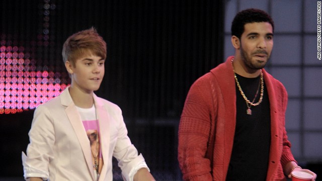 "Drake, seen here with Bieber in 2011, is another star who's taken the young singer under his wing. According to Braun, Drake is one of the first people to rip into Bieber after spotting a tawdry headline about him in the news. ""He'll text me, like, 'What the hell is going with this? I'm pissed. I'm calling him right now. I'm about to go in on him,' "" Braun told THR in 2013."