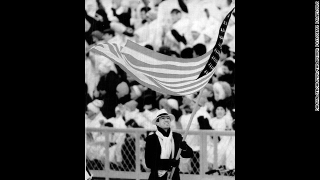 U.S. athletes at the 1988 Winter Olympics in Calgary, Alberta. Biathlete Lyle Nelson carries the flag during the opening ceremony.