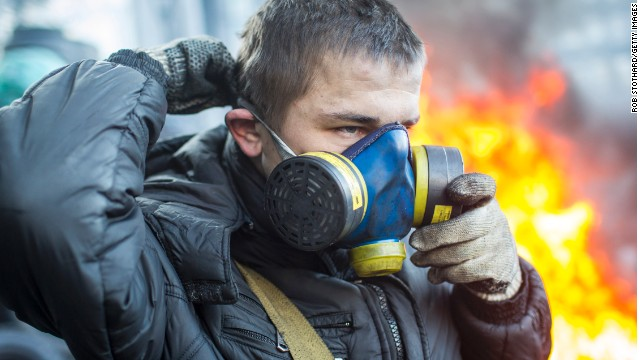 A protestor puts on a gas mask near Dynamo Stadium in Kiev on January 24.