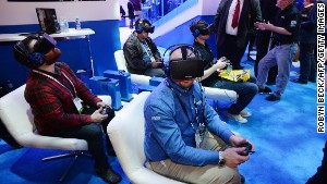Attendees wear Oculus Rift HD virtual reality headsets as they play a multiplayer virtual reality dogfighting shooter game at CES in January.