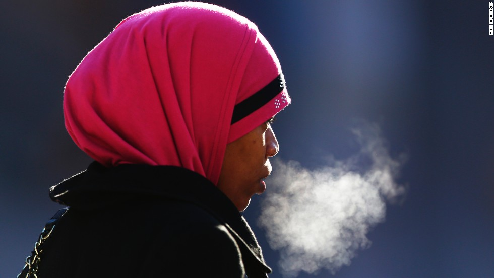 A woman exhales in the freezing temperatures of Philadelphia on Thursday, January 23. Driven by frigid arctic air, a powerful system is making a mess of things up and down the Eastern Seaboard, especially from Washington to Boston. More than a foot of snow has fallen in parts of the Northeast.