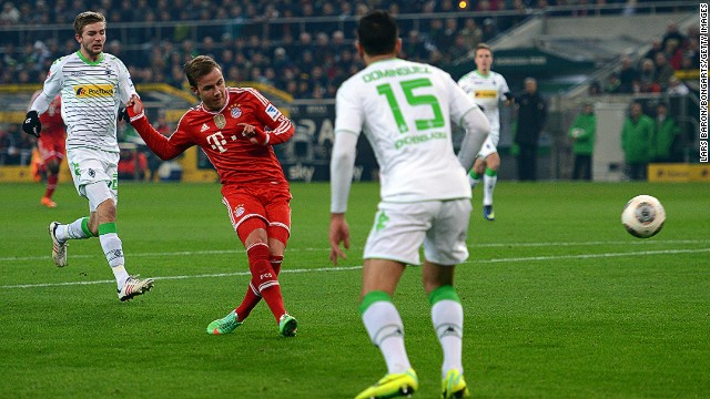 Mario Gotze sweeps home Bayern Munich's first goal against Monchengladbach as the Budesliga resumed on Friday night.
