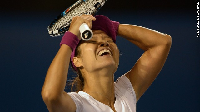 Li Na savors the moment of victory. The fourth seed in Melbourne overcame Slovakia's Dominika Cibulkova in straight sets 7-6 (7-3) 6-0 to win her first Australian Open title.