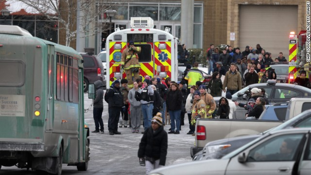 Police evacuate employees and patrons from the Columbia Town Center Mall after a shooting resulting in fatalities there on January 25 in Columbia, Maryland.