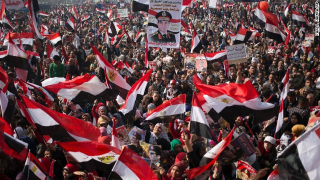 Pro-military demonstrators wave national flags and hold pictures of Defense Minister Abdel-Fattah el-Sisi, who was a key figure in the ouster last summer of democratically elected President Mohamed Morsy, and who recently hinted at a run for the presidency himself.