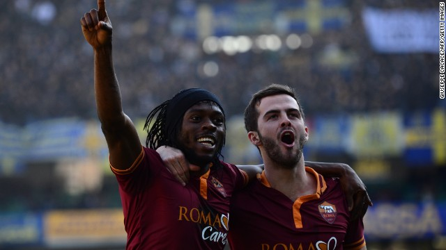 Roma striker Gervinho (left) celebrates with teammate Miralem Pjanic. Both players have blossomed under Garcia's tutelage.