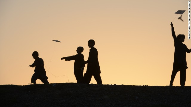 In this file photo, Pakistani children fly their kites near Islamabad. Six children playing in a field in rural Pakistan were killed Sunday when a hand grenade they mistook for a toy exploded, police said.