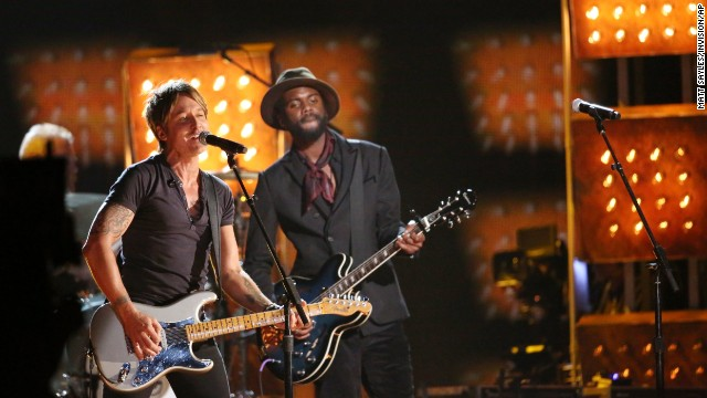 "Country star Keith Urban, left, and Gary Clark Jr. perform ""Cop Car."""