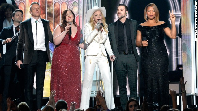 "From right, Queen Latifah, Ryan Lewis, Madonna, Mary Lambert and Macklemore share the stage. Madonna sang her classic ""Open Your Heart."""