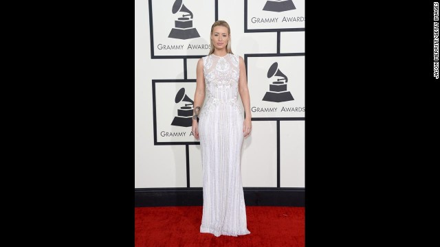 """Iggy Azalea was a class act in this all-white gown a the Grammy Awards. Subtle, but also sexy. We give it an """"A."""""""