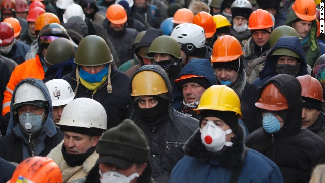 Protesters march in Kiev on Monday, January 27. Activists say they want wide-ranging constitutional reform and a shake-up of the Ukrainian political system.