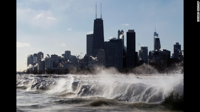 Ice forms as waves crash along the Lake Michigan shore January 27 in Chicago.