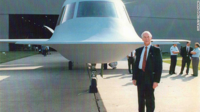 Civilian test pilot Richard G. Thomas stands in front of Tacit Blue during its unveiling at the National Museum of the U.S. Air Force in 1996. Thomas piloted the aircraft on its maiden flight in February 1982.