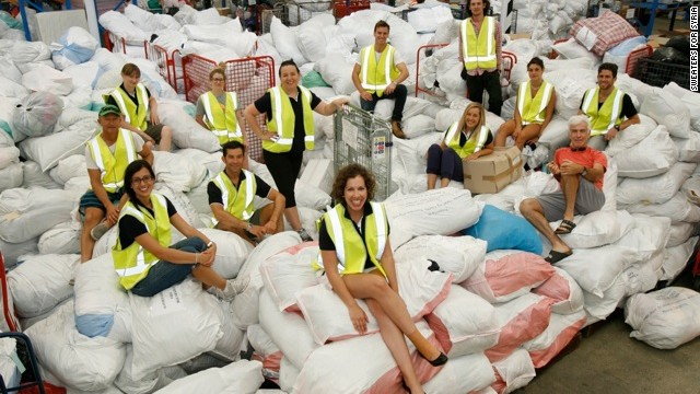 Australian volunteers help pack the Sweaters for Syria into containers. The woman behind movement, Ranya Alkadamani, is in the foreground.