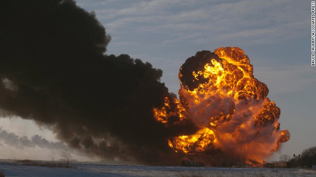 A fireball goes up at the site of an oil train derailment in Casselton, North Dakota, on December 30, 2013. There were no reports of injuries from the accident.