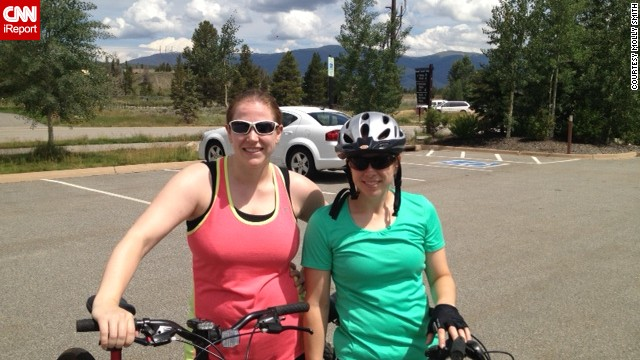 She's an accomplished athlete; she played sports in college and loves to bike. She's pictured here with her younger sister, Ashley, mountain biking in Colorado.