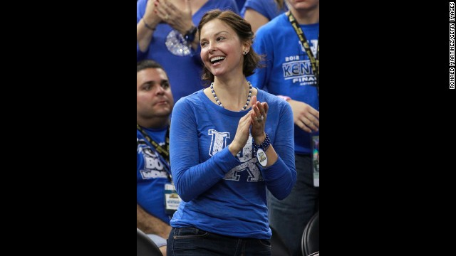 Ashley Judd cheers on the Wildcats at her alma mater, the University of Kentucky, where she got an undergraduate degree in French. She later completed a master's degree in public administration at Harvard's John F. Kennedy School of Government.